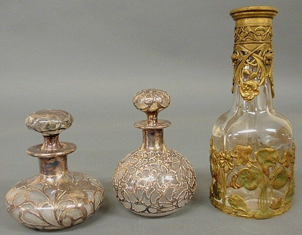 97: Two c.1900 sterling silver overlay perfume bottles
