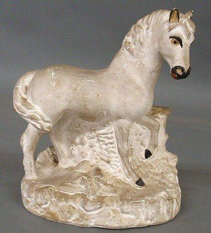 "18: Chalkware standing horse, c.1870. 10""h.x8""w."