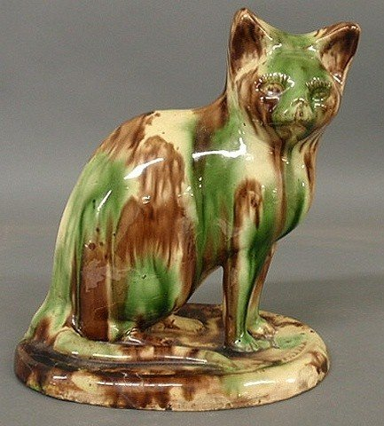 19: Redware seated cat with mottled green and brown g