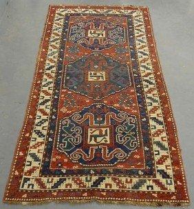 1: Kazak oriental hall carpet with three blue medall