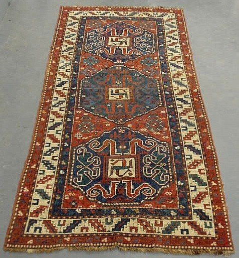 1: Kazak oriental hall carpet with three blue medall