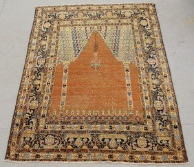 7: Persian oriental prayer carpet with orange field.