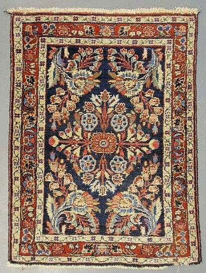 7D: Oriental mat, blue field and floral patterns. 2'11""