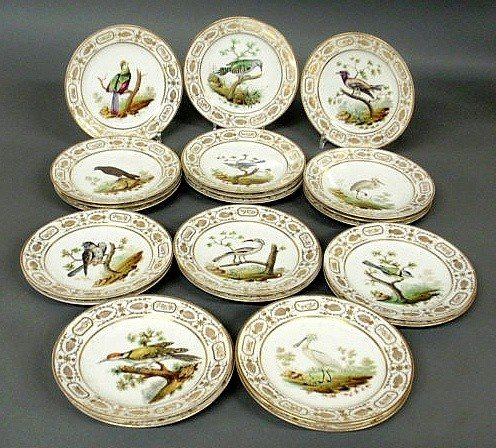 13: Twenty-two hand painted bird plates, c.1860, with