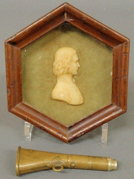 18: Wax side profile portrait of a man, mounted in a
