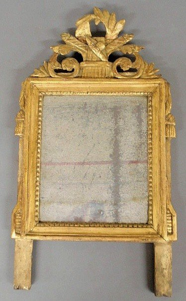 20: Early Continental gilded mirror with a carved cre