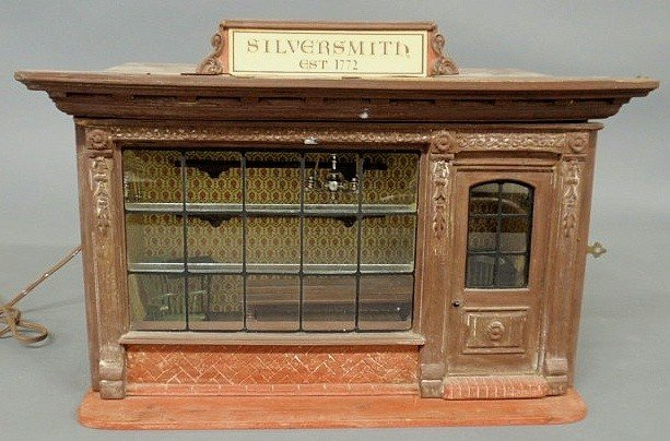 "129: Metal and wood toy Colonial ""Silversmith Shop"" wi"