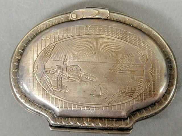 12: Early oval silver change purse, 19th c., the fron