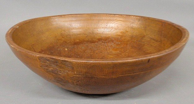 "16: Large carved pine bowl, 19th c. 7""h.x21.25""diam."