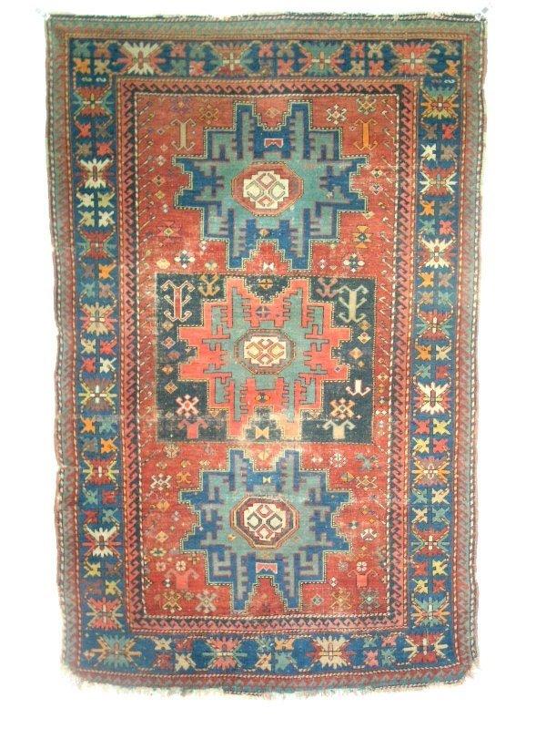 6: Kazak center hall carpet with three center medallion
