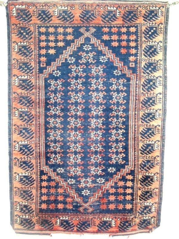 17: Baluch oriental mat, blue field, red border and sta