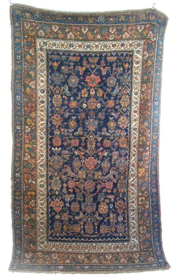 22: Oriental hall carpet, blue field and floral pattern