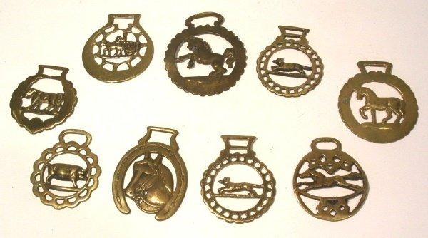 39: Nice grouping of nine horse brasses.