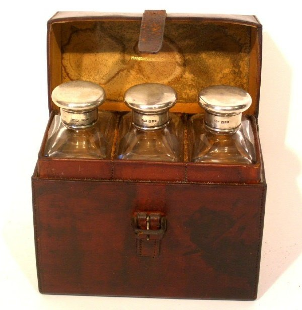 41: Unusual English leather cased decanter or toiletry