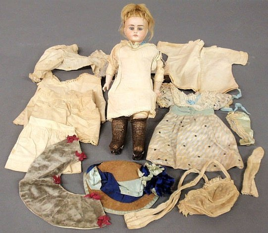 34: Bisque head doll, 19th c., with a stitched kid le