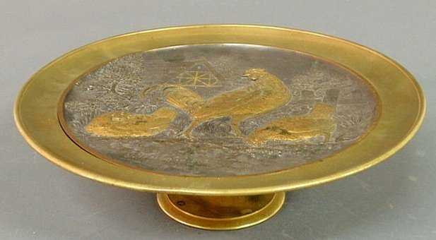 38: Brass tazza with relief rooster and chicken figur