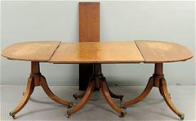 180 Inlaid mahogany dining table 19th c  with a tri