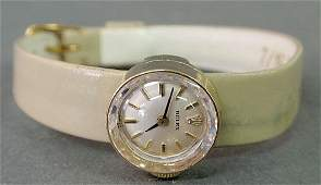 204 Ladies 14k gold Rolex wristwatch with an Italian