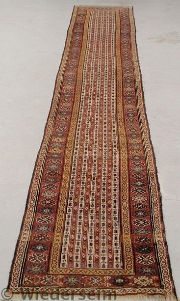 1: Long Persian oriental hall runner with a floral r