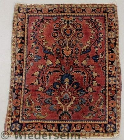 2: Sarouk oriental mat with a red field and floral p