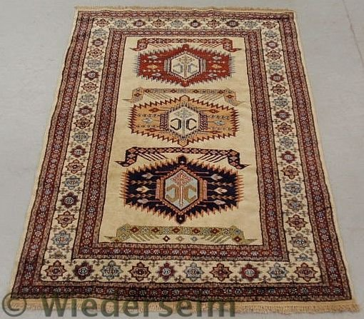 5: Caucasian oriental center hall carpet with an ivo