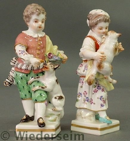 9: Two small Meissen figures- a boy with a dog and g