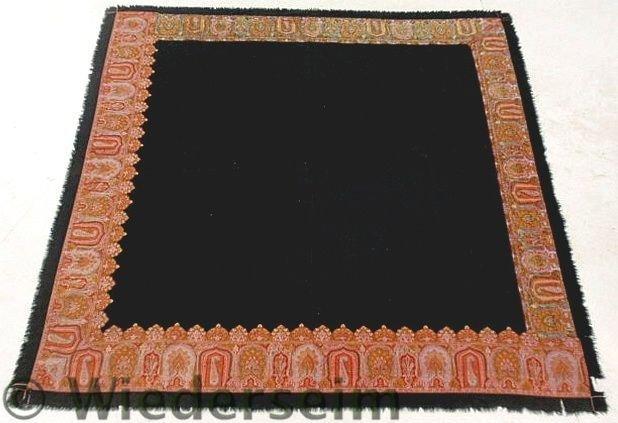 26: Black homespun table cover with paisley border. 6