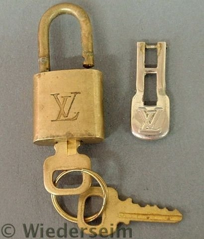 76: Small brass Louis Vuitton padlock with two keys a