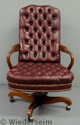 """131: Red leather executive office chair labeled """"South"""