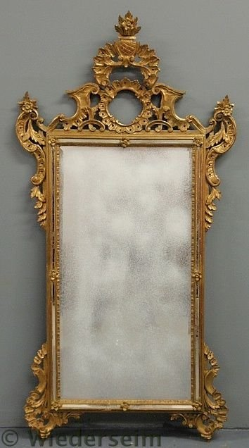 145: Italian carved gilt mirror, 19th c., with acanthu