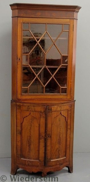 146: English mahogany corner cupboard with a molded co