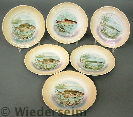 "151: Set of six German decorated fish plates. 8""dia."