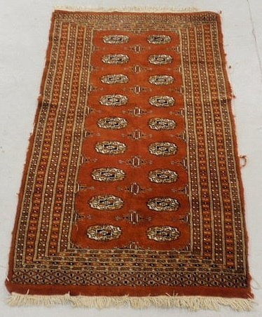 2B: Bokhara oriental center hall carpet with a red fi