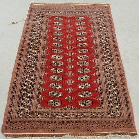 6B: Bokhara oriental center hall carpet with geometri
