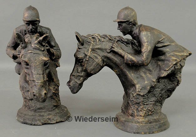 165: Pair of cast iron horse and rider bookends, 20th c