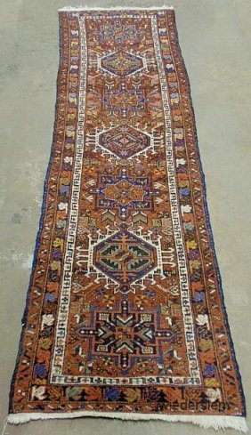 1: Heriz oriental hall runner with seven geometric meda