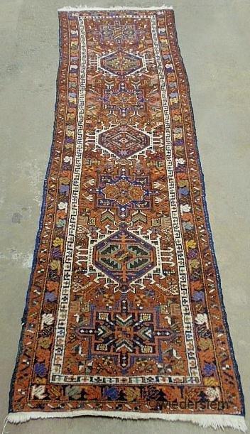 1: Heriz oriental hall runner with seven geometric meda