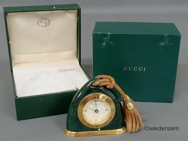 20: Gucci malachite cased Swiss travel alarm clock, wit