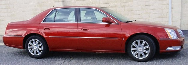 2008 Cadillac DTS four-door sedan, cherry red with ligh