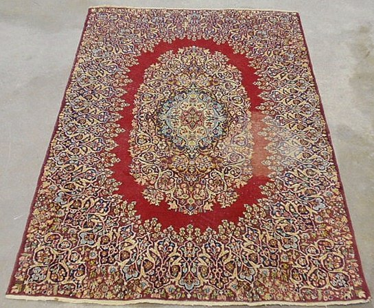 Kerman oriental hall carpet with a red field and overal