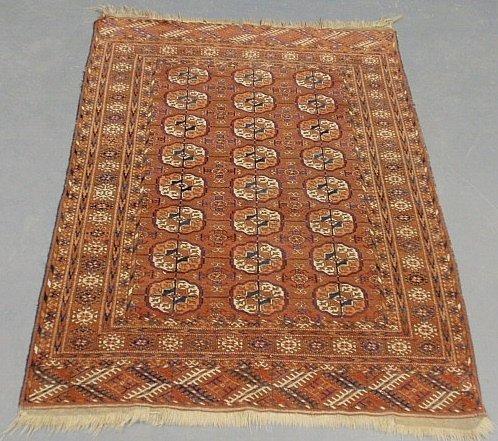 Bokhara oriental mat, red field and geometric patterns.