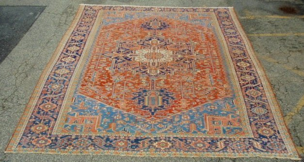 Palace size Heriz oriental carpet with a center geometr
