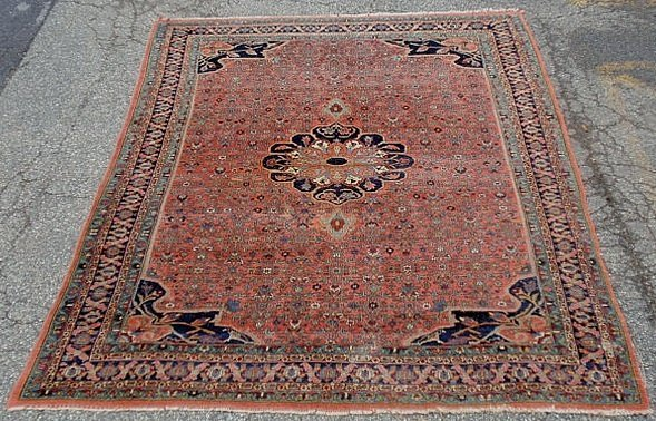 Persian room size oriental carpet with a center medalli