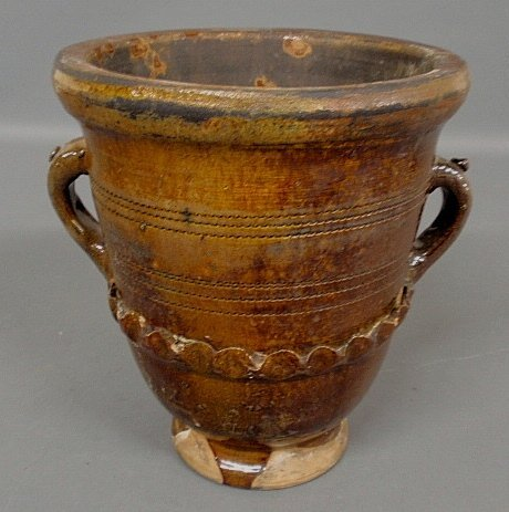 Large redware double-handled flower pot, 19th c., with