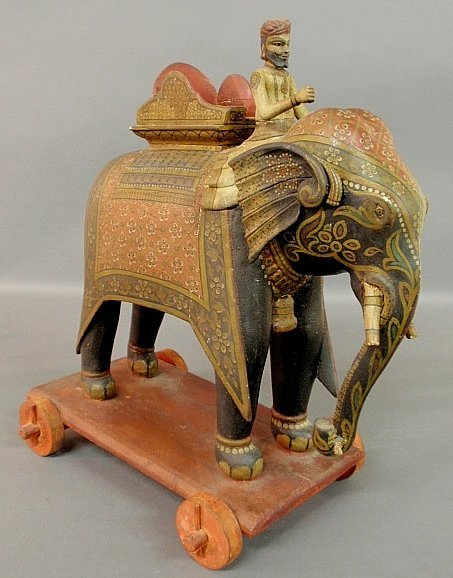 Carved and paint decorated Indian elephant with driver,
