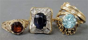 Three ladies rings a 14k gold and topazcolored crysta