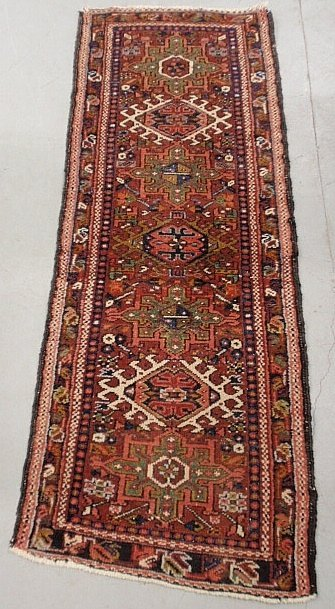 Heriz oriental hall runner with a red field and center