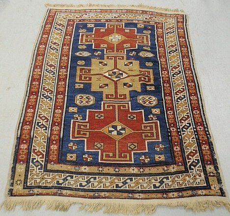 Colorful Kazak oriental mat with geometric patterns. 3'