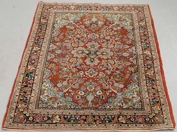 Sarouk oriental mat with a red field, blue border and f