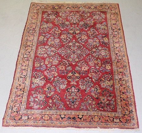 Sarouk oriental mat with overall floral patterns. 5'x3'